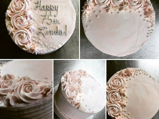 Triple layer vanilla bean cake with raspberry and lemon curd fillings, elegant rose-scented buttercream and tiny edible pearls.