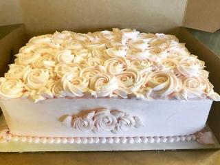 Vanilla Bean Cake, raspberry filling, rose-scented buttercream