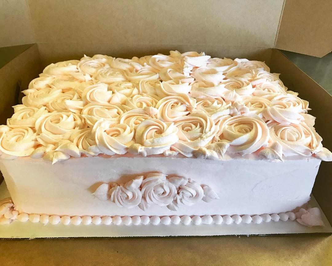 Vanilla Bean Cake, raspberry filling, rose-scented buttercream